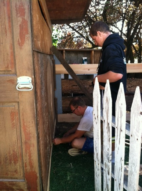 Dad showing son how to do it. He may not want to build things but he will know how!!! Love my gate by the way!