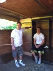 The guys take a break. The walls up and the entertainment center (nesting boxes) installed!