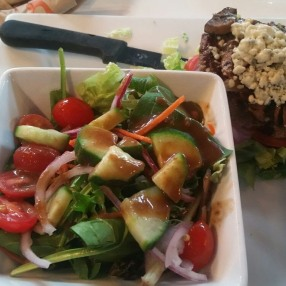 Burger on a bed of lettuce and salad, yum